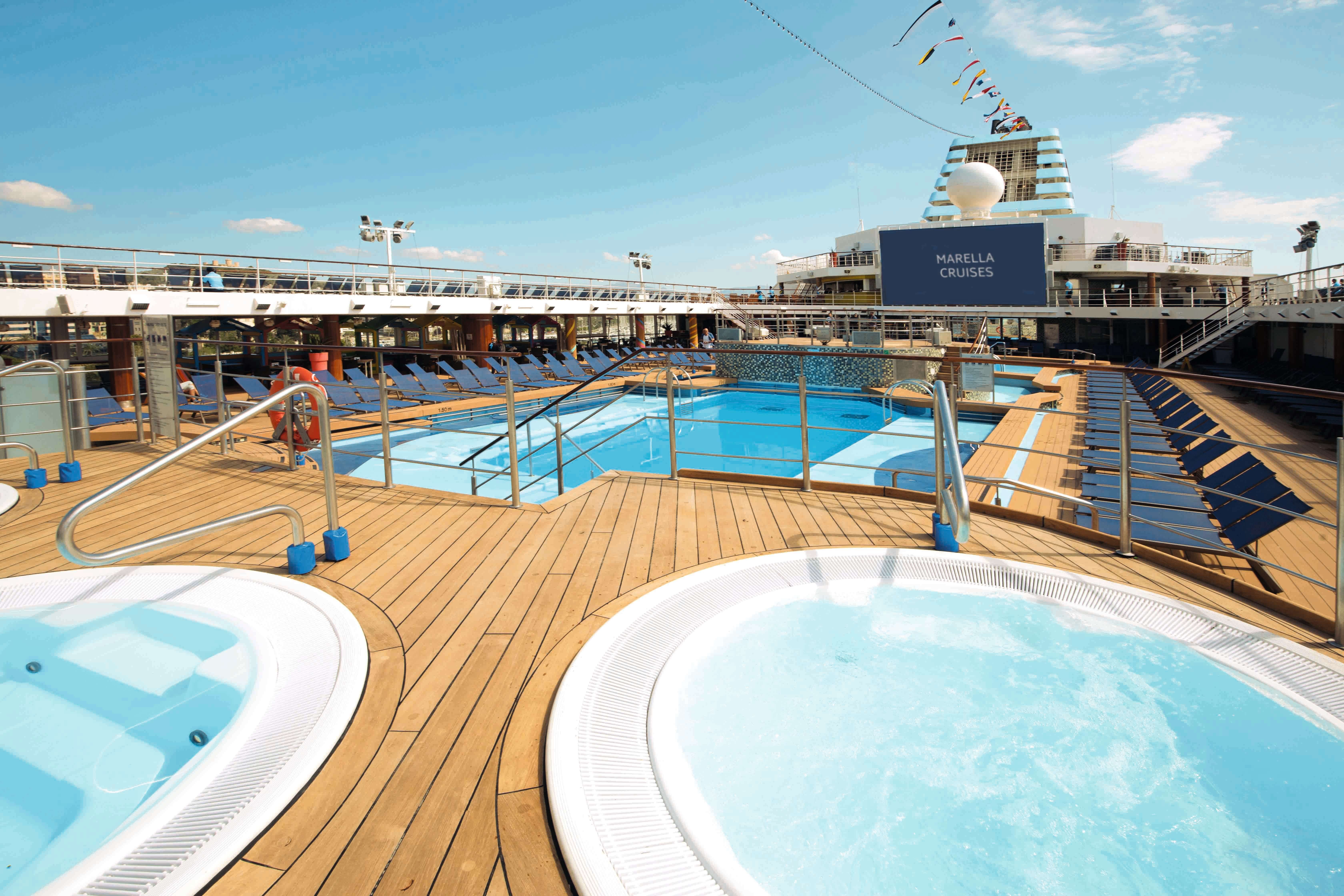An image of Marella Explorer 2's main pool area, with a swimming pool and hot tubs