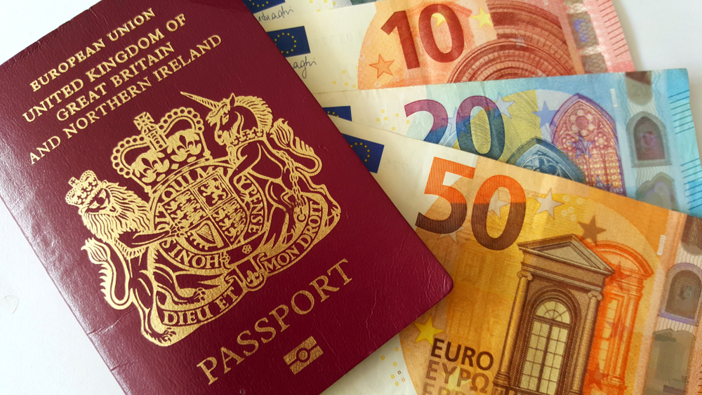 An image of a passport and some Euro notes