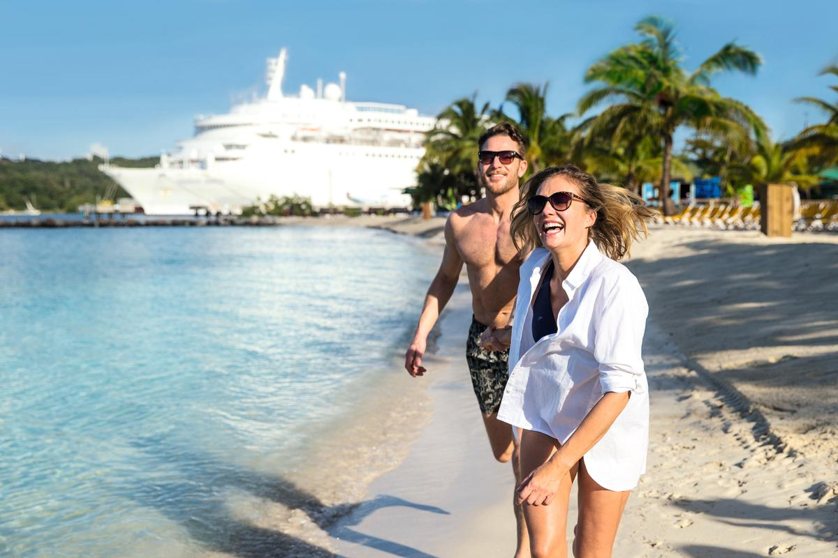 Couple happy on beach whilst holidaying on Marella Dream