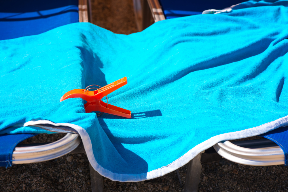 Image showing pegs keeping towel attached to sun bed